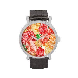 el caramelo lleva el bocado abstracto del dulce de reloj de mano