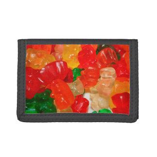 el caramelo lleva los dulces rojos coloridos de la