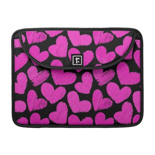 El carrito incompleto de los corazones del rosa y  fundas para macbooks