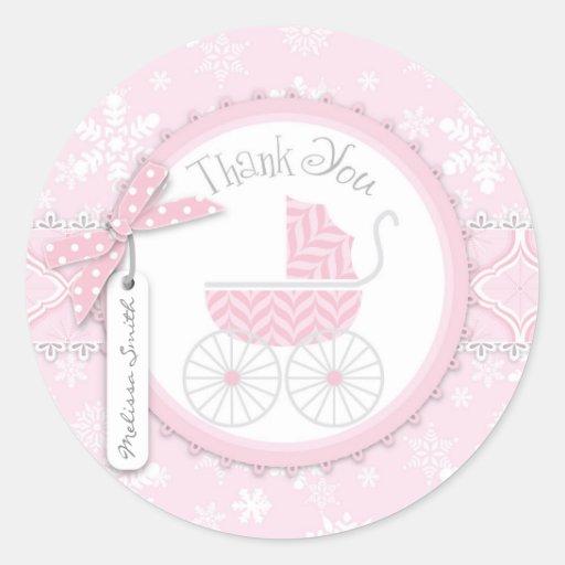 El carro de bebé y el copo de nieve rosados del etiquetas redondas