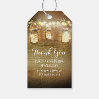 El casarse rústico de las luces de los tarros de etiquetas para regalos