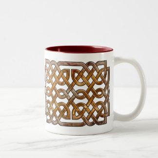 el celtic se entrelaza tazas de café