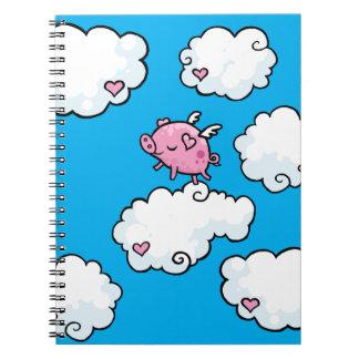 El cerdo del vuelo baila en el cuaderno espiral de