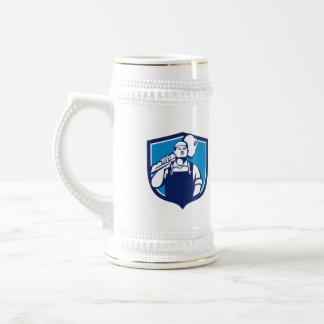 El cerrajero lleva el escudo dominante del hombro jarra de cerveza