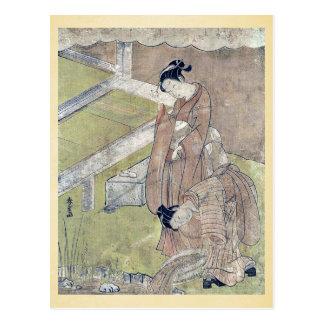 El chica lanza un pescado en una charca por Suzuki Postales