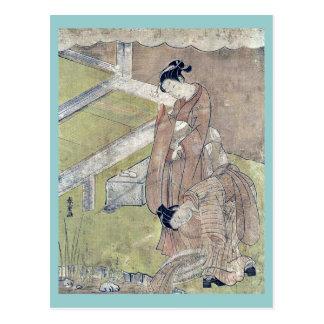 El chica lanza un pescado en una charca por Suzuki Tarjeta Postal