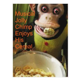 El chimpancé alegre musical goza de su cereal postal