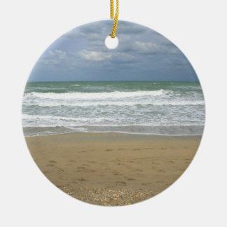 El cielo de la arena del océano se descoloró fondo ornamento para reyes magos