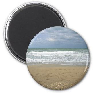 El cielo de la arena del océano se descoloró fondo iman para frigorífico