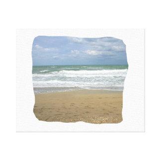 El cielo de la arena del océano se descoloró fondo impresiones en lienzo estiradas