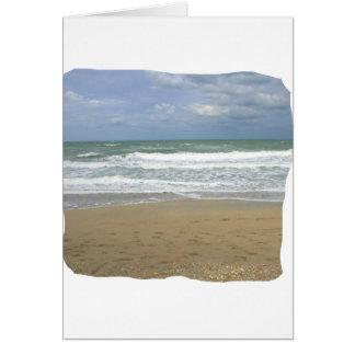 El cielo de la arena del océano se descoloró fondo tarjeta