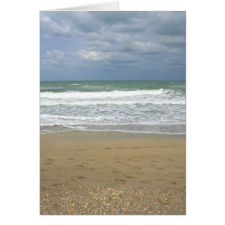 El cielo de la arena del océano se descoloró fondo tarjetón