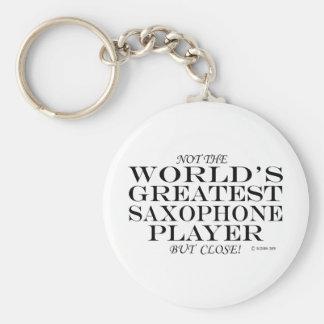 El cierre más grande del jugador de saxofón llavero redondo tipo pin
