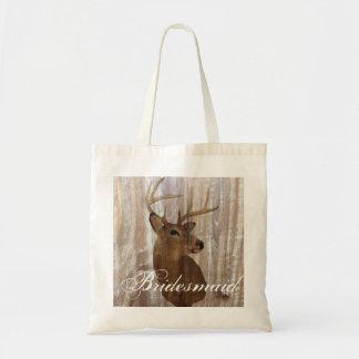 el ciervo de madera rústico la caza está sobre bolsa tela barata