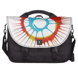 El círculo de colores del diseño, pared, forma la  bolsas para portatil