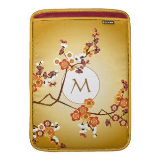 El ciruelo japonés florece rama del rojo anaranjad funda para macbook air