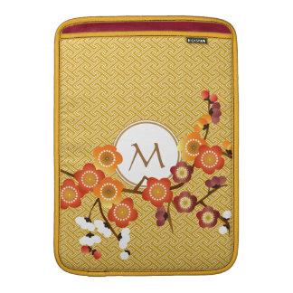 El ciruelo japonés florece rojo anaranjado del oro fundas MacBook