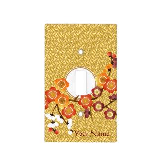 El ciruelo japonés florece rojo anaranjado del oro placa para interruptor