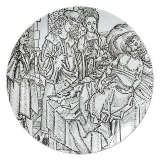 El cirujano y los ayudantes visitan a un hombre gr platos de comidas