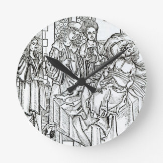 El cirujano y los ayudantes visitan a un hombre gr reloj de pared