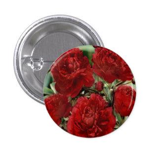 El clavel rojo florece el botón pin redondo de 1 pulgada