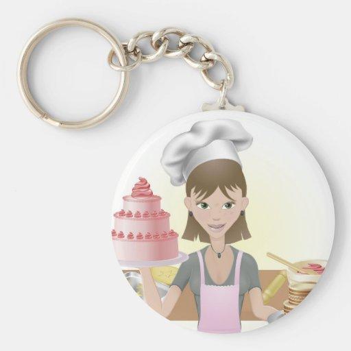El cocer de la mujer joven tortas y galletas llaveros