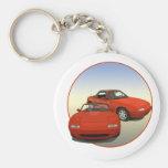 El coche de deportes rojo del arte de la avenida llaveros