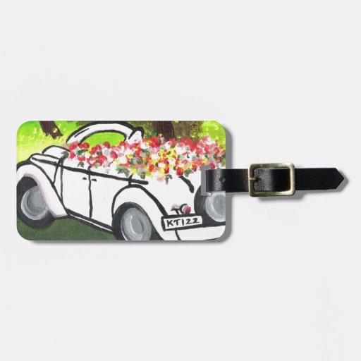 El coche y la primavera del vintage florece (el ar etiquetas bolsa