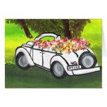 El coche y la primavera del vintage florece (el ar tarjeta de felicitación