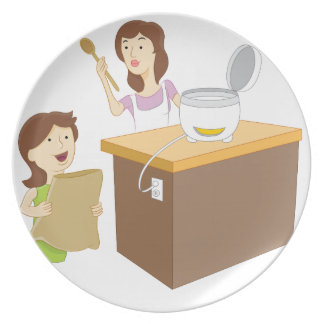 El cocinar de la madre y de la hija plato de cena
