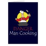 El cocinar del hombre del peligro tarjetón