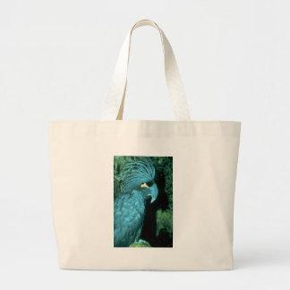 El cockatoo de la palma tiene cabeza-vestido impon bolsa