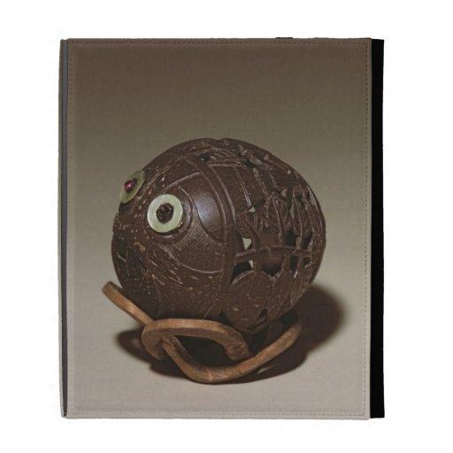 El coco esculpió en una cara, c.1895