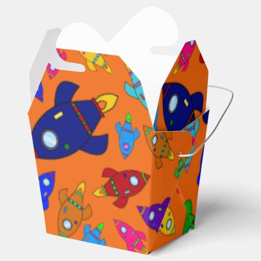 El cohete anaranjado lindo envía el modelo cajas para regalos de fiestas