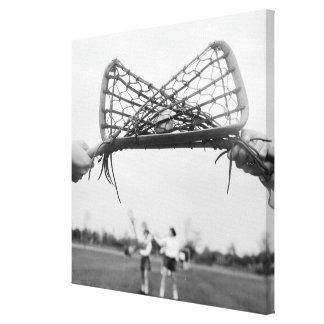 El comienzo del juego en un lacrosse combina con impresión en lienzo