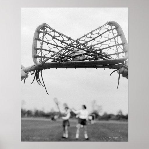 El comienzo del juego en un lacrosse combina con póster