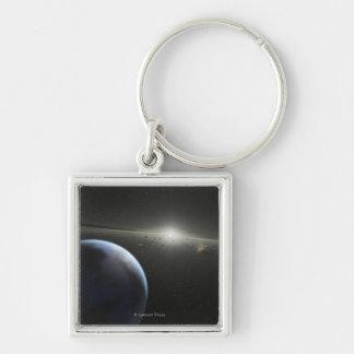 El concepto del artista de una fotografía astroide llavero cuadrado plateado