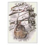 El conejito de la nieve sazona saludos tarjeton