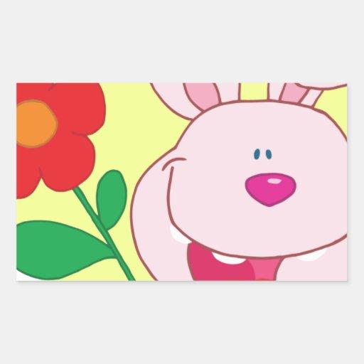 El conejito feliz sostiene la flor pegatina rectangular