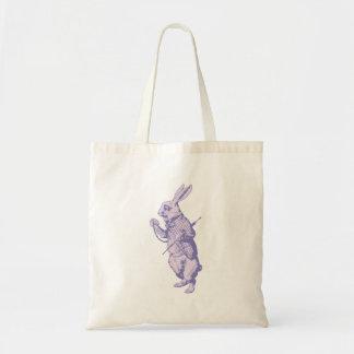 El conejo blanco entintó la lavanda bolsas