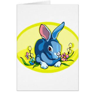 el conejo que se sienta azul florece oval.png tarjeta pequeña