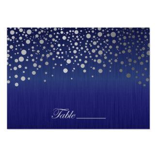 El confeti de plata elegante puntea el azul del tarjetas de visita grandes