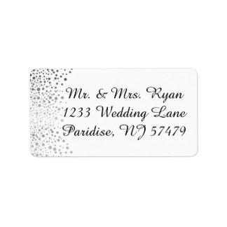 El confeti de plata elegante puntea el fondo etiquetas de dirección