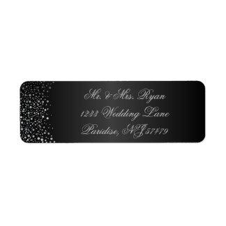 El confeti de plata elegante puntea el negro del | etiqueta de remite