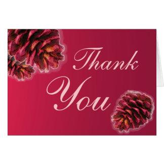 El cono rosado rústico del pino marrón le agradece