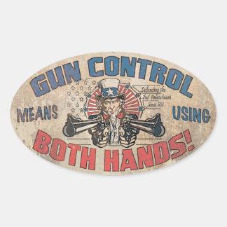 El control de armas significa ambas manos pegatina oval personalizadas