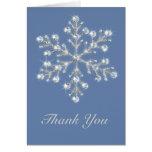 El copo de nieve cristalino hivernal le agradece c felicitación