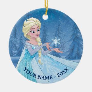 El copo de nieve de cogida de Elsa el   añade su Adorno Navideño Redondo De Cerámica