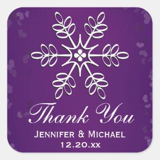 El copo de nieve púrpura le agradece etiquetar pegatina cuadrada