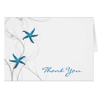 El coral azul de las estrellas de mar y de la tarjeta pequeña